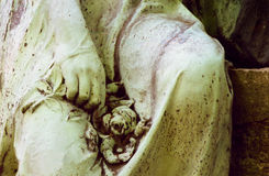 Stone roses. Detail of a statue at a cemetery in Leipzig, Germany Stock Image