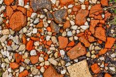 Stone rubble underfoot. Grunge background texture. Stock Photos