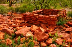 Stone Ruins. Old falling down red stone house ruins Royalty Free Stock Photo