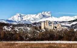 Stone Ruins in France near Aix en Provence. With a snowy mountain backdrop Stock Photo