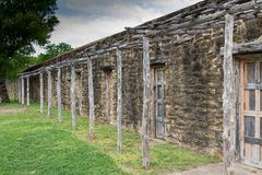 Stone ruins with rustic woodwork. On doors and front porch posts and roof Stock Images
