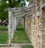 Stone ruins with timber frame front porch. Long side view of stone ruins with timber frame front porch with green grass Royalty Free Stock Photos