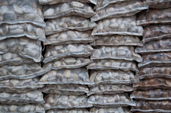 Stone in sack for sale in thailand Stock Photos