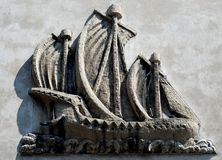 Stone_sailing_ship. Stone sailing ship - relief on tenement facade in Cracow royalty free stock image