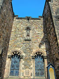 The stone saint in the castle wall Royalty Free Stock Photos