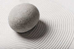 Stone in the sand and circles around him Royalty Free Stock Images
