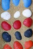 Stone in sand Stock Photos