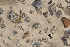 Stone on the sand. Granite stones on the sand Royalty Free Stock Photo