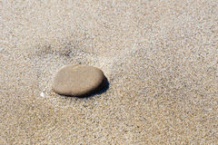 Stone on Sand Stock Photography