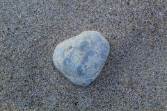 Stone on the sand. Sea side Royalty Free Stock Photography