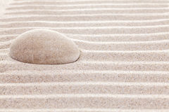 Stone in sand, spa or spiritual background Stock Photography