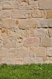 Stone sandstone wall and grass Royalty Free Stock Photography
