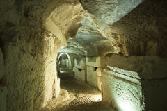 Stone Sarcophagi In Israel. A series of large stone coffins or sarcophagi line the walls of an extensive series of tunnels carved into the soft chalk or Royalty Free Stock Photo