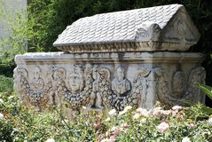 Stone sarcophagus. Remains of an ancient sandstone sarcophagus in a garden Stock Image