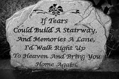 Stone With Saying. If tears could build a stairway and memories a lane, I'd walk right up to heaven and bring you home again Stock Images