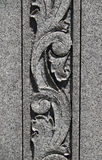 Stone Scroll Carving. A stone carving of floral-type scrollwork, shot in strong sunlight to highlight the deep lines Stock Photo