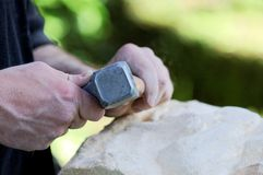 Stone sculptor. At work on piece of stone Stock Images