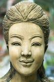 Stone sculpture of an asian women Stock Photo