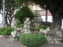Stone sculpture of a child, dog and horse Stock Photo