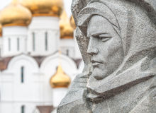 Stone sculpture and church in Yaroslavl, Russia. Royalty Free Stock Images