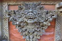 Stone sculpture decorating a temple wall Royalty Free Stock Images