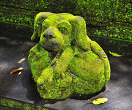Stone sculpture in the dog shape Stock Photo