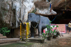 Stone sculpture of an elephant. Stone sculpture of an elephant at the entrance to the cave Buddhist temple stock image