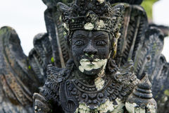Stone sculpture on entrance door of the Temple in Bali Royalty Free Stock Photo