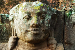 Stone sculpture face stock photography