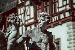 Man Stone Sculpture in Front Of Castle royalty free stock images