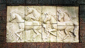 Stone sculpture of horse. On wall Royalty Free Stock Photos