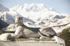 Stone sculpture of a leopard  of snow mountains Stock Photo