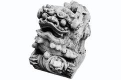 The stone sculpture of a lion gate guardian of the temple Royalty Free Stock Photography