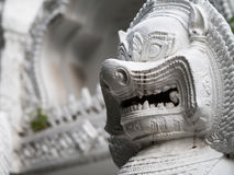 The stone sculpture of a lion gate guardian  of the temple Royalty Free Stock Photos