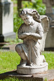Stone sculpture of the little angel Royalty Free Stock Images