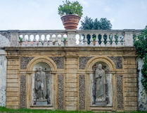 Stone sculpture monument to the two emperors generals with flower beds in park at Villa Pamphili in Rome, capital of Italy Royalty Free Stock Photography