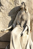 Stone sculpture at Monumental Cemetery, Milan. Stone sculpture at large monumental Cemetery in town, shot in bright late winter light  in Milan, Lombardy, Italy Royalty Free Stock Photography
