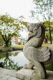 Stone sculpture of myth by pond,China Royalty Free Stock Photography