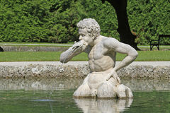 Stone sculpture at palace garden Hellbrunn Stock Images