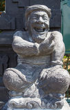 Stone sculpture representing the old man Stock Photography