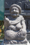 Stone sculpture representing the old woman Stock Image