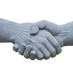 Stone sculpture of shaking hands isolated on white background Royalty Free Stock Photo
