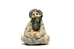 A stone sculpture of a sitting man isolated Royalty Free Stock Image