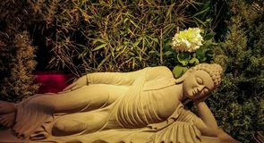 stone sculpture of sleeping lord buddha closed up stock photo