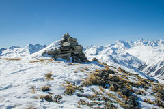 Stone sculpture on the summit. Frozen stone sculpture on a summit in Livigno Stock Photo