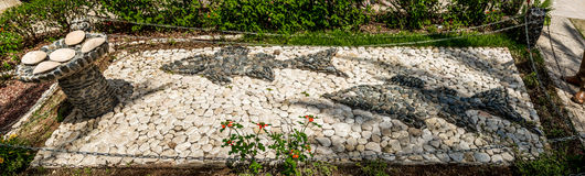Stone sculpture, two fish and five loaves of bread, Church of Mount of Beatitudes, Israel Royalty Free Stock Photography
