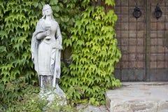 Stone sculpture of a woman Stock Photos