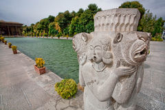 Stone sculpture of woman and lions near the pool of Persian palace Hasht Behesht in Iran. Stock Photo