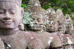 Stone sculptures at the Angkor Thom in Siem Reap, Cambodia. Stock Images