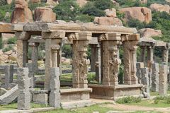 Stone sculptures and bas-reliefs on columns at the entrance to Pushkaran. Pushkarani is a sacred lake on the way to the Vitthala t. Emple in Hampi, Karnataka Royalty Free Stock Images